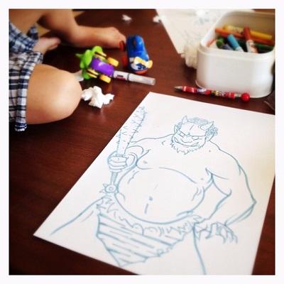 Luke's son playing next to Luke's drawing of a Demon