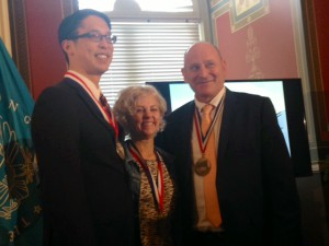 Kate DiCamillo, Jon Scieszka, and me. For some reason, Jon's medal is waaay heavier than Kate's and mine.